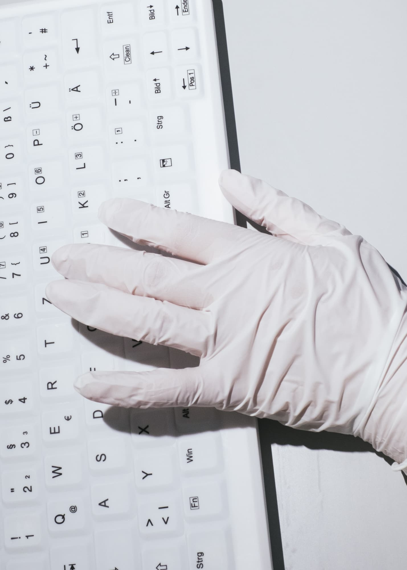 Nicht muede werden — Hand detail of a nurse typing on a computer