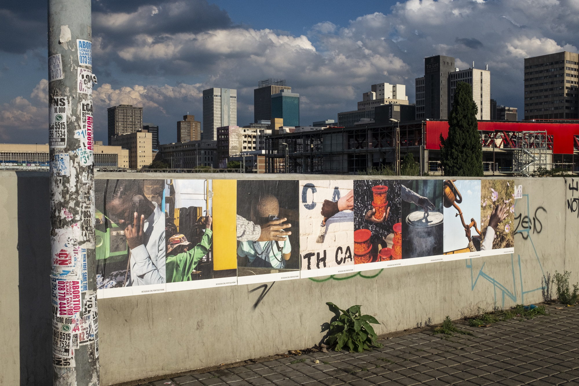 """Documentation of the street art exhibition of """"How to get home"""" in Johannesburg, South Africa, November 2019, funded by the Stiftung Kulturwerk Grant. Poster set in Johannesburg CBD, Queen Elizabeth Bridge on Nov 23rd, 2019."""