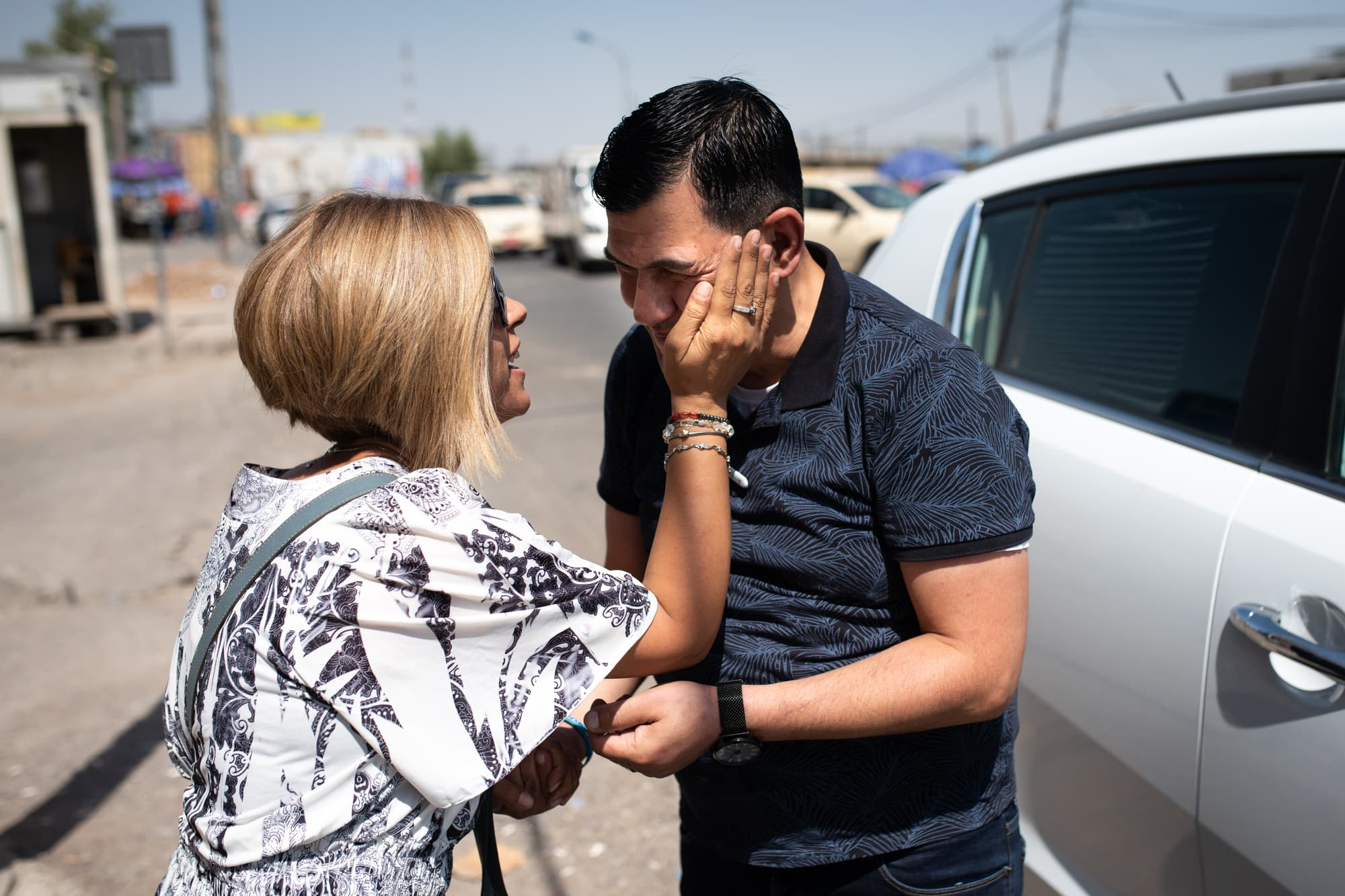 Abdullah Kurdi says goodbye to his sister Tima Kurdi on the 01.09.2019 after the have been buying school uniforms at the market. They are close.