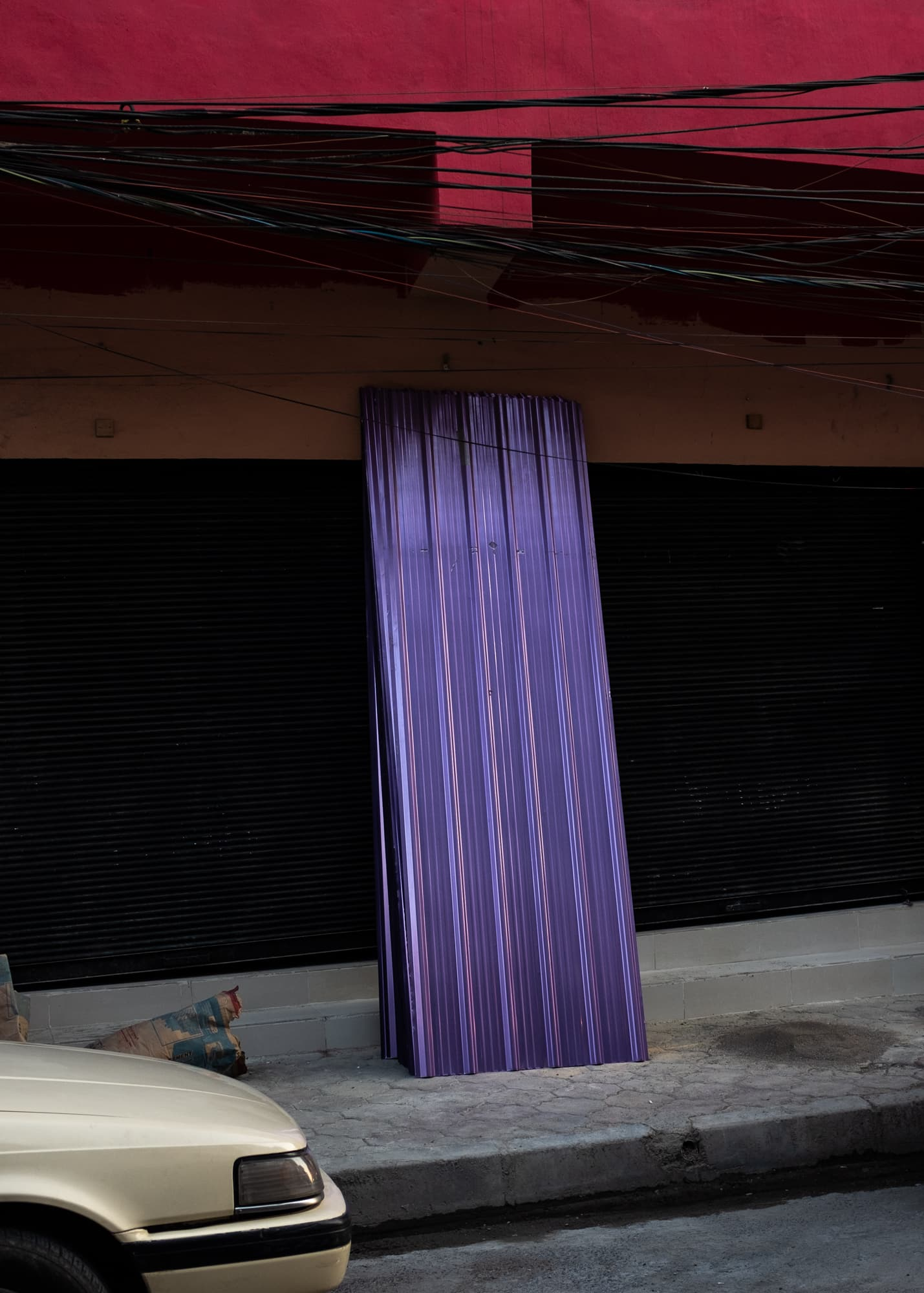 A purple piece of corrugated iron in the streets of Ankawa, the Christian quarter of Erbil, Iraq on September 1st, 2019.