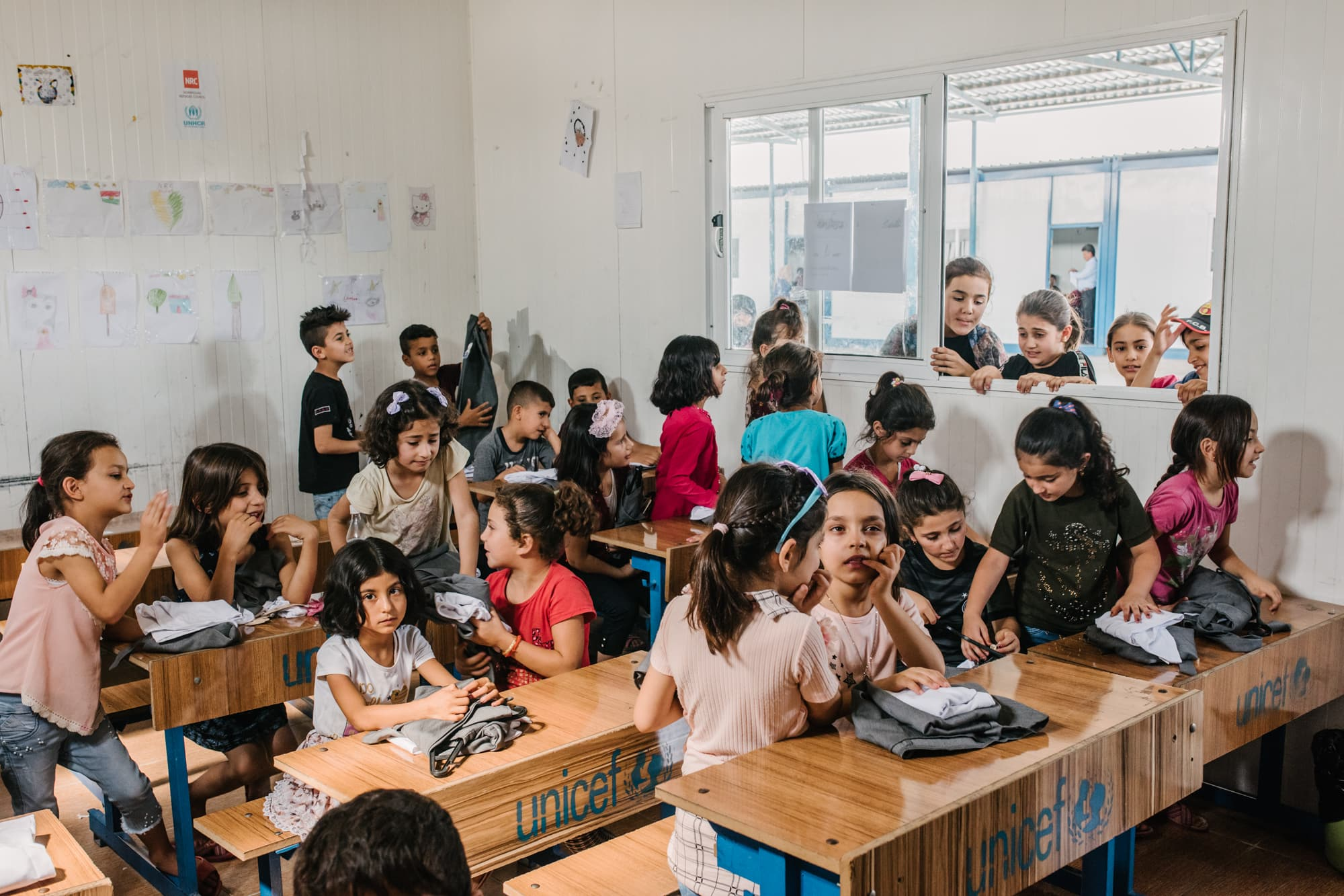 A class checks out the new school uniform at school at Gawilan refugee camp, Iraq, Sept 2nd, 2019, which they received from Abdullah Kurdi, father of Alan Kurdi.