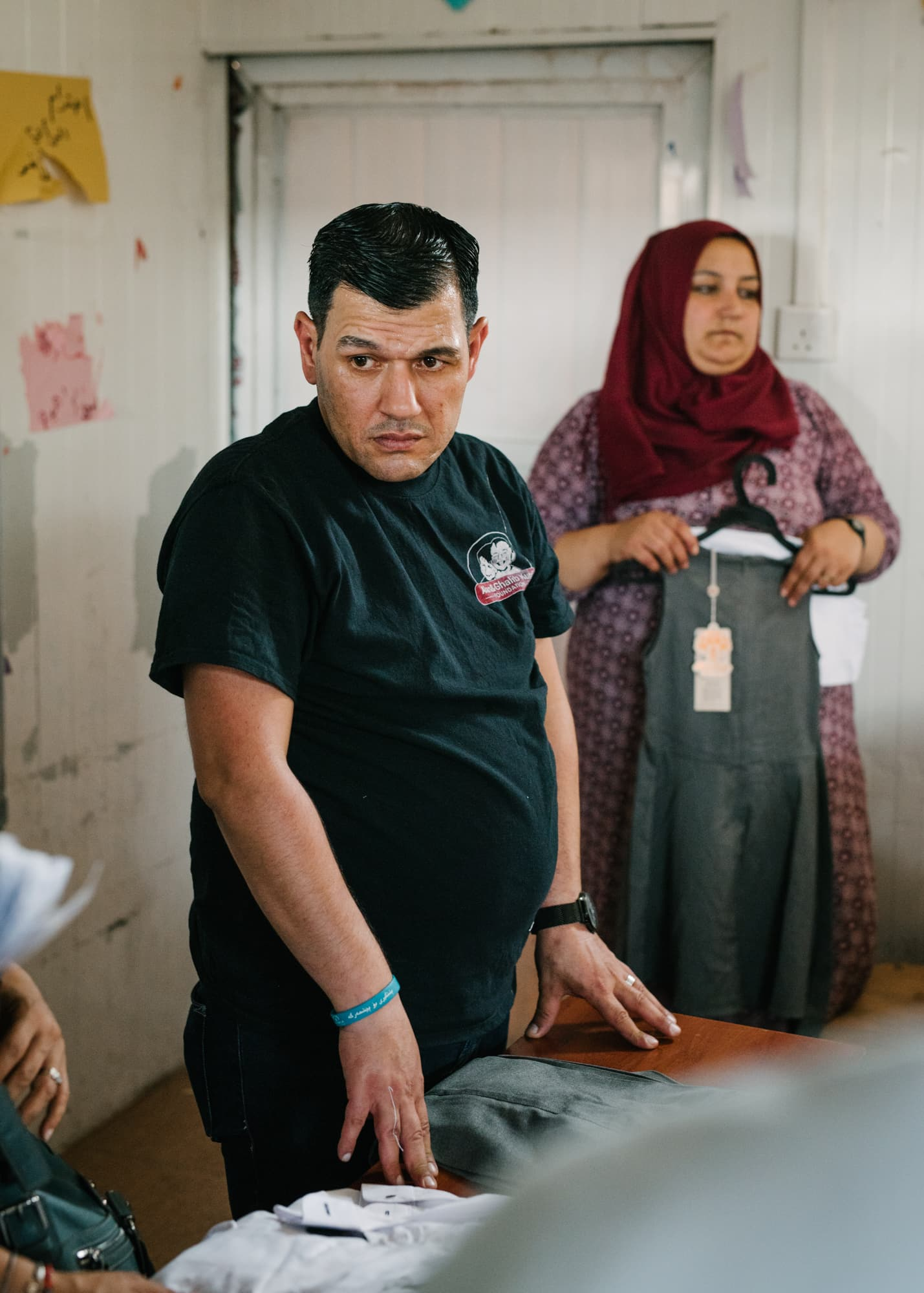 Abdullah Kurdi during a break while distributing school uniforms which he bought with the money from the Alan and Ghalib Kurdi foundation at the school, at Gawilan refugee camp, Iraq, Sept 2nd, 2019.