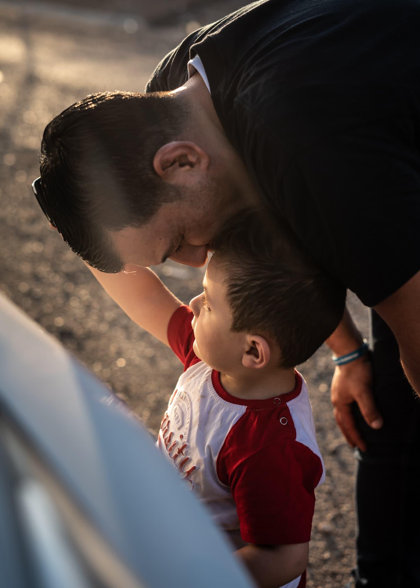 Abdullah Kurdi caresses Mirhad, son of a friend at Gawilan refugee camp, Iraq, on Sept 2nd, 2019.
