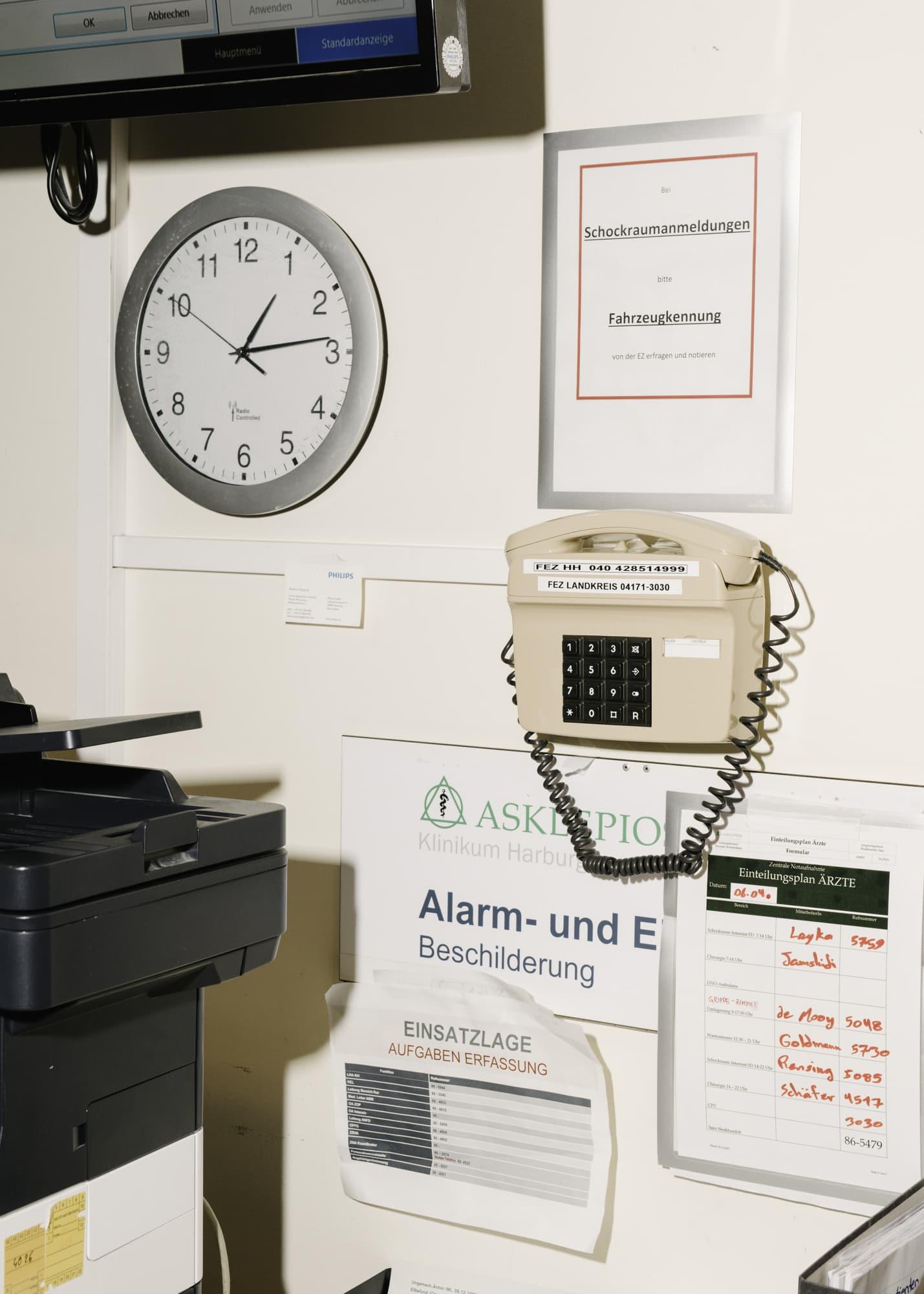 emergency phone an a wall in the emergency room